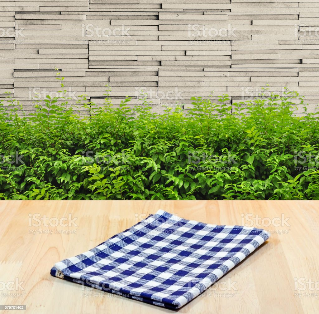 blue tablecloth on wood material background for product display. stock photo