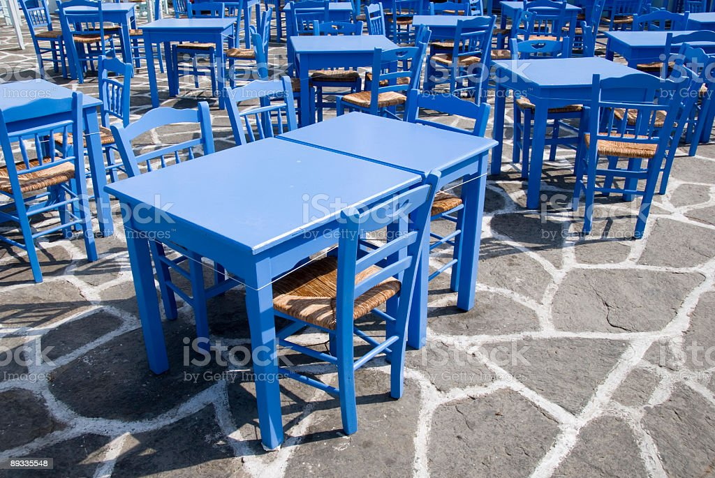 Blue tables and chairs in Greece royalty-free stock photo