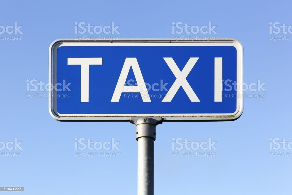 Blue taxi sign stock photo