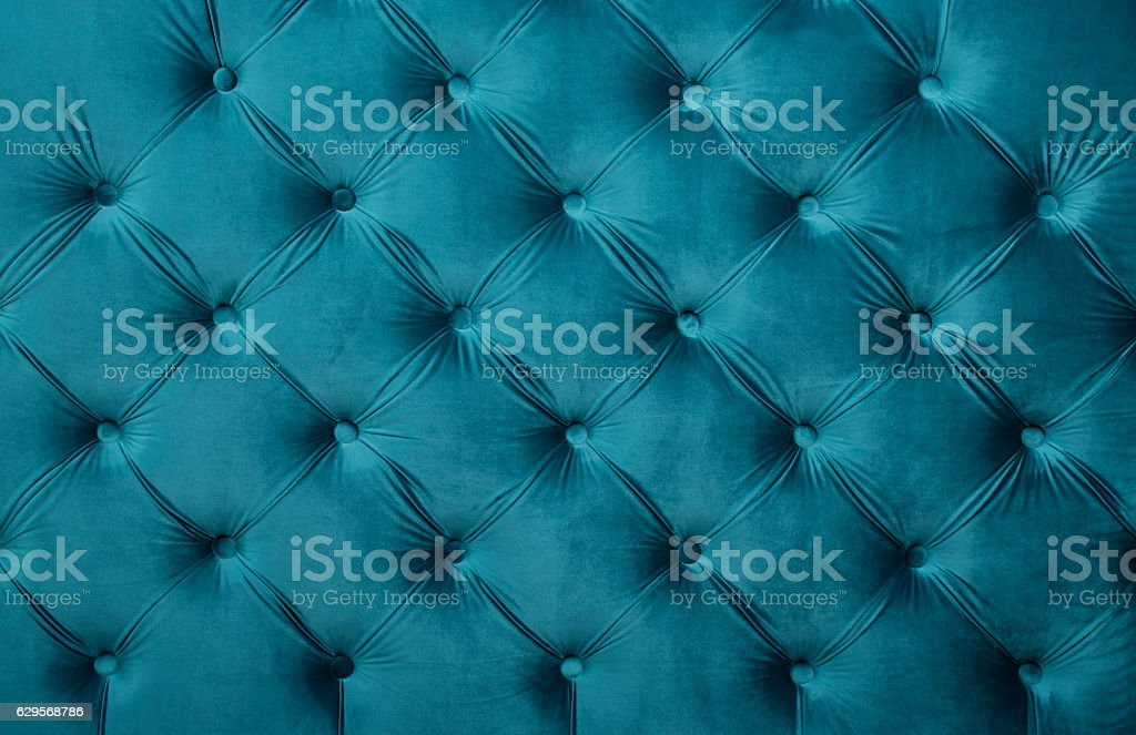 Blue teal capitone tufted fabric upholstery texture stock photo