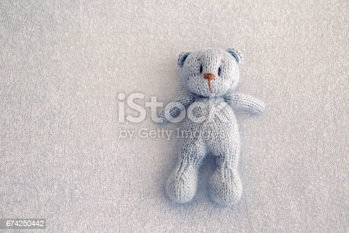 istock Blue teddy bear knitted toy 674250442