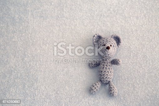 istock Blue teddy bear knitted toy 674250692