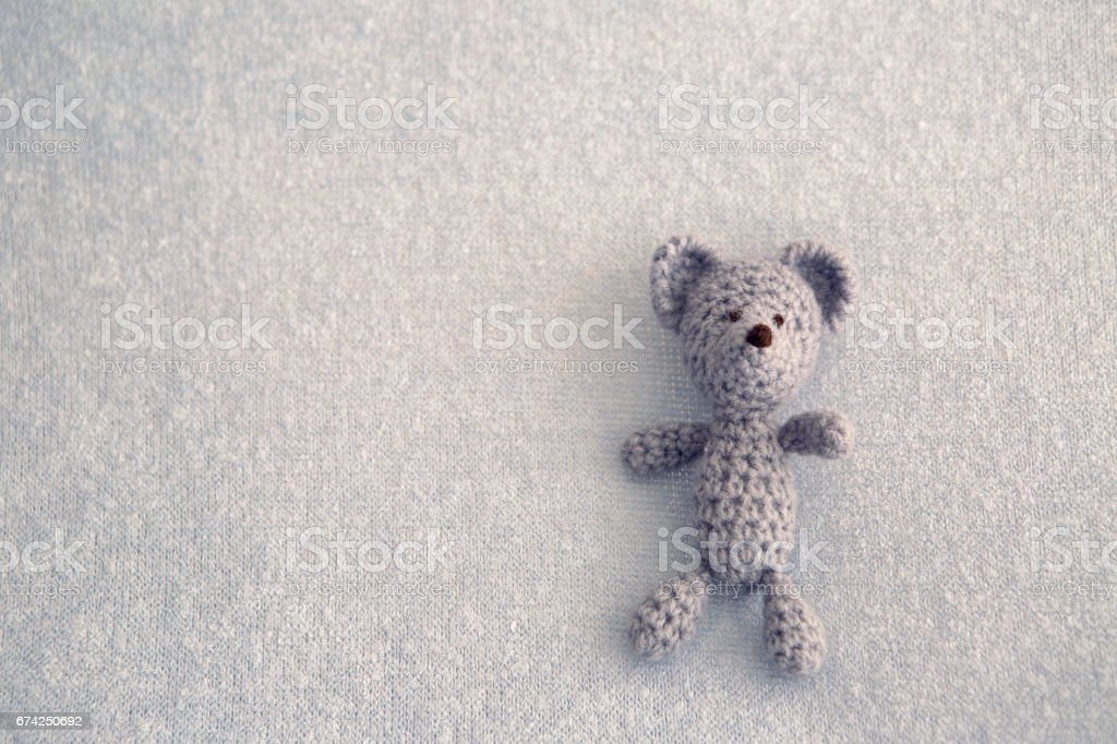 Blue teddy bear knitted toy stock photo