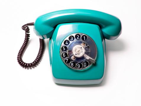 blue telephone, white background