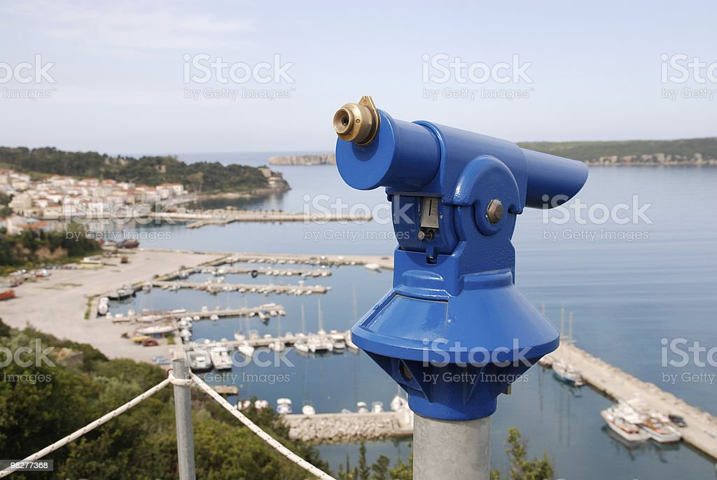 blue telescope at viewpoint over old port of Pylos, Greece royalty-free stock photo