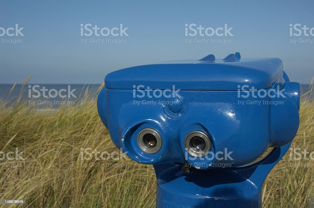 Blue telescope on the beach stock photo