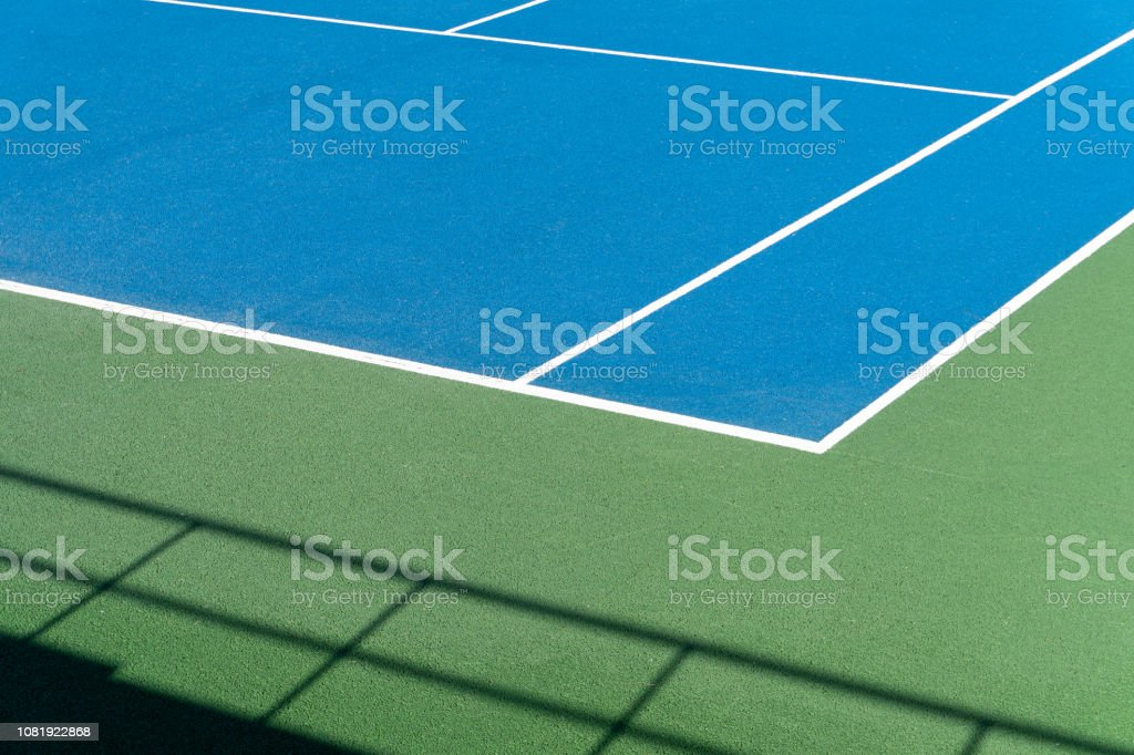 Blue Tennis court. Outdoor sunny day. Tennis concept. Copy space stock photo