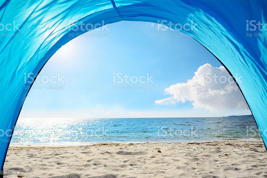 blue tent by the shore in Sardinia stock photo