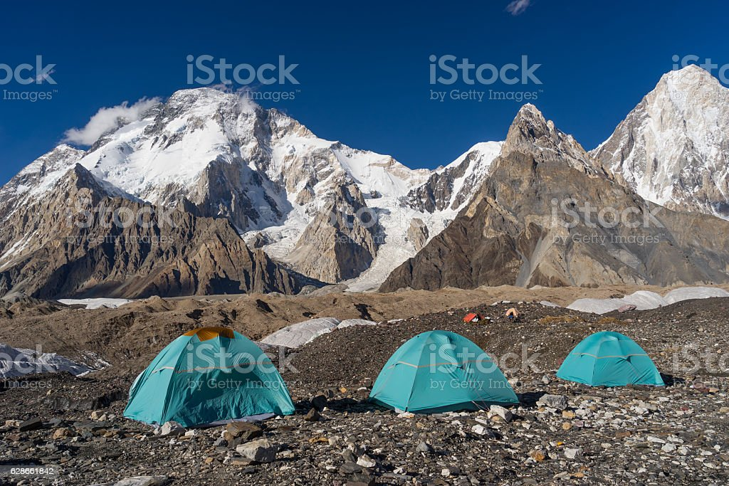 Blue tents at Concordia in front of Broadpeak, K2 trek stock photo