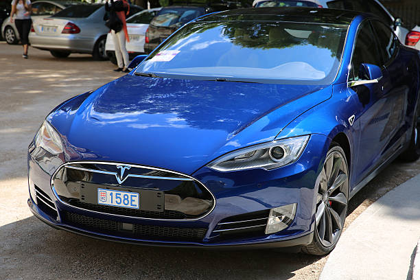Blue Tesla Model S P90D Nice, France - May 15, 2016: Blue Tesla Model S P90D Car Parked in Front of the Nice Orthodox Church tesla model s stock pictures, royalty-free photos & images