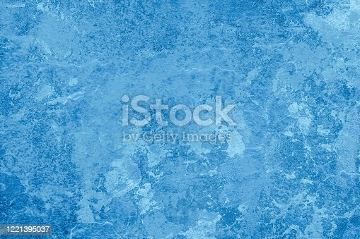 istock Blue texture, background similar to ice, wall, water or natural mineral with cracks and patterns 1221395037
