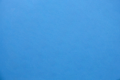 Blue soft foam material matte surface with tiny grainy rough textured pattern abstract background design for presentation, banner, brochure wallpaper