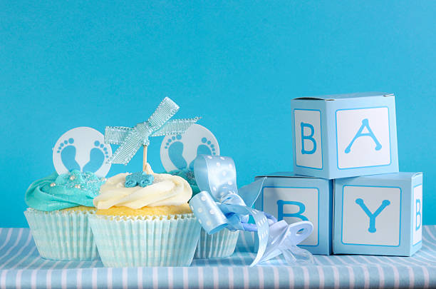 Blue theme baby boy three cupcakes and favor gift boxes stock photo