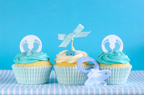 Blue theme baby boy three cupcakes stock photo