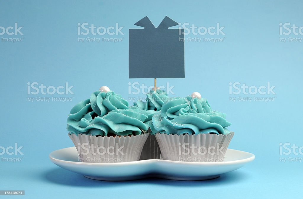 Blue theme cupcakes with gift tag sign. royalty-free stock photo