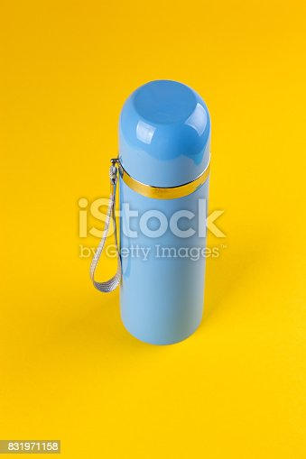 istock Blue thermos for hot drinks 831971158