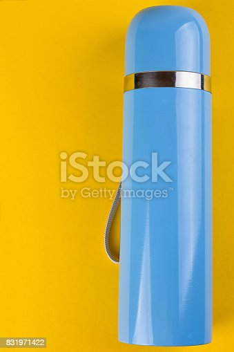istock Blue thermos for hot drinks 831971422