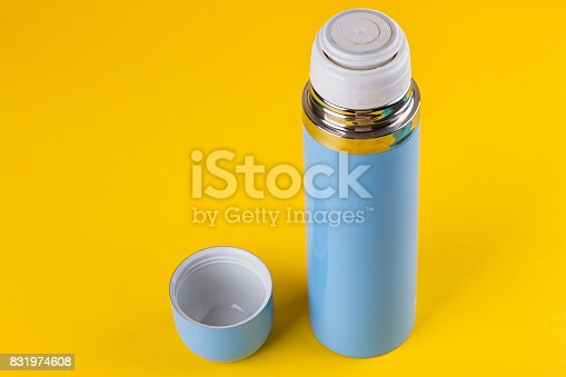istock Blue thermos for hot drinks 831974608