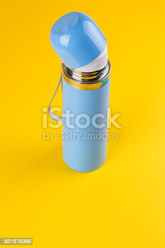 istock Blue thermos for hot drinks 831976366