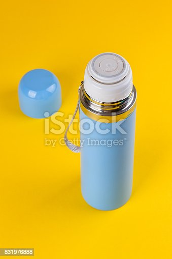 istock Blue thermos for hot drinks 831976888
