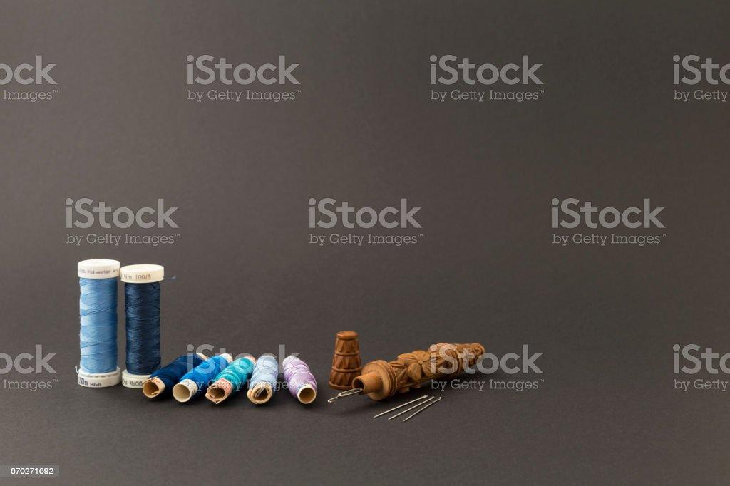 Blue thread spools with needles stock photo