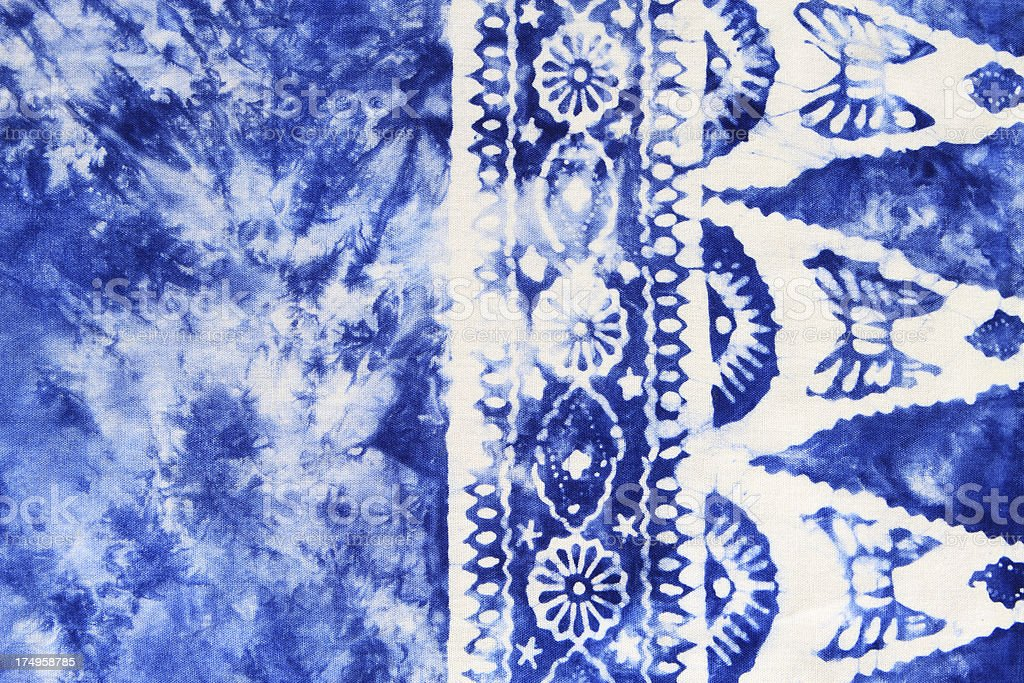 Blue tie-dyed fabric with border stock photo