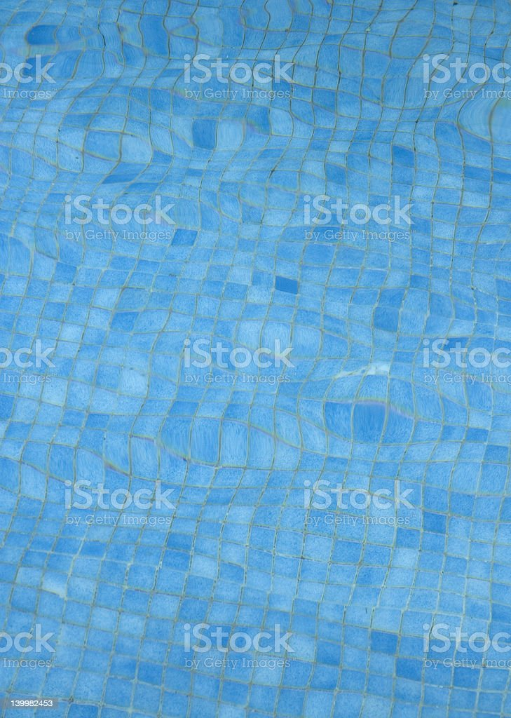blue tiles background - bottom of a swimming pool royalty-free stock photo