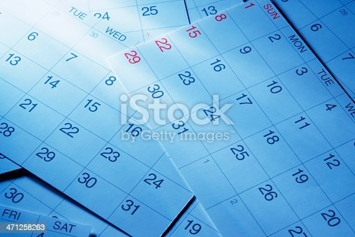 istock Blue tinted image of calendars with light rays 471258263