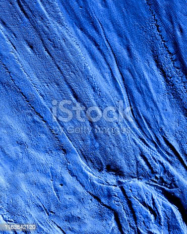 Blue tinted image of abstract dirty plaster texture background.