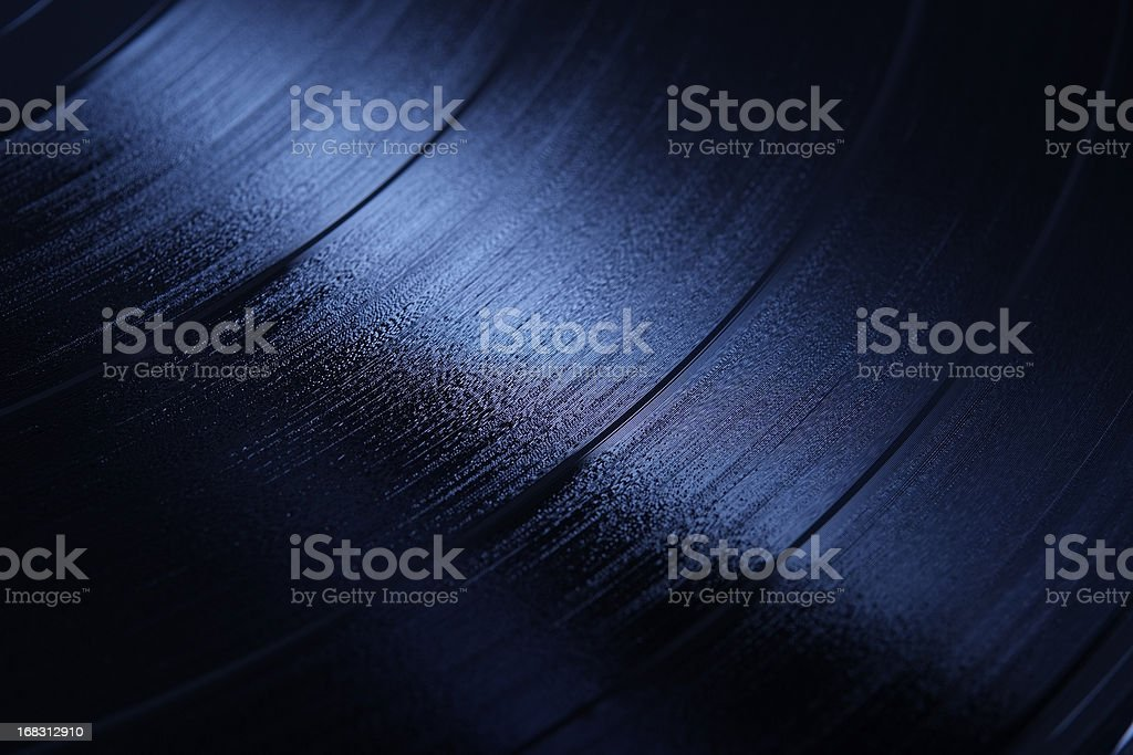 Blue tinted image of shiny Record  (LP) stock photo