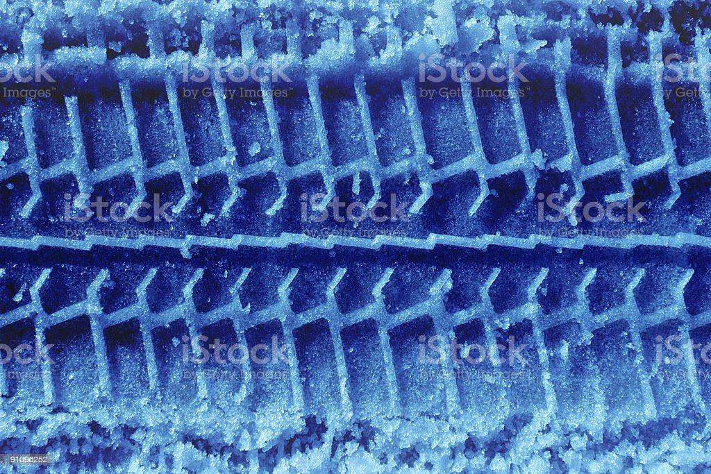 Blue tireprint on snow royalty-free stock photo