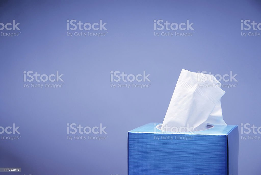 Blue tissue box with white tissue stock photo