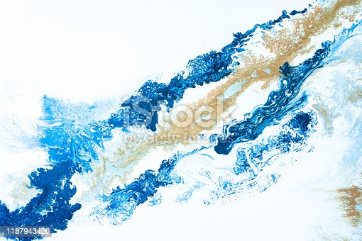 istock Blue tone and gold beige background graphic from acrylic pour art showing liquid formations. 1187943426