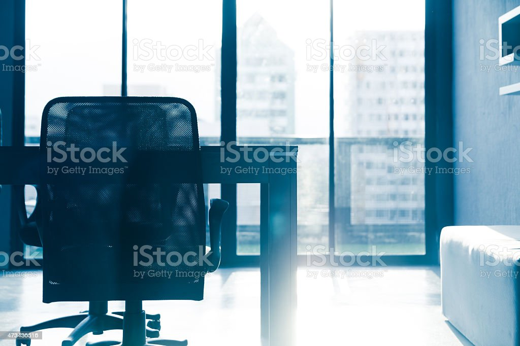 Blue tone silhouette of empty conference table and chairs stock photo