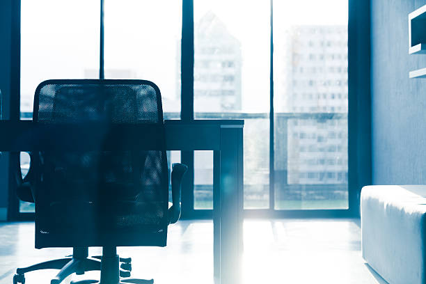 Blue tone silhouette of empty conference table and chairs blue tone of  conference table and chairs with sun light in meeting room ,business  room empty desk stock pictures, royalty-free photos & images