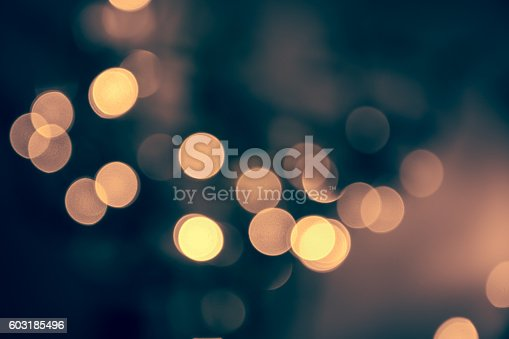 istock Blue toned blurred chrismas  background  with street lights 603185496