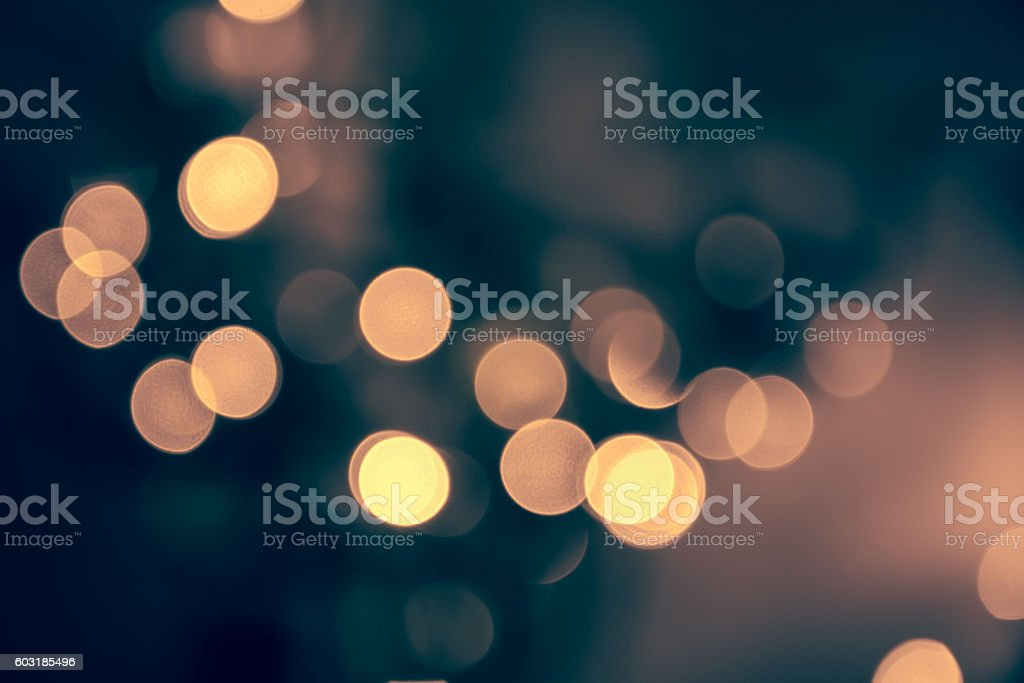 Blue toned blurred chrismas  background  with street lights stock photo