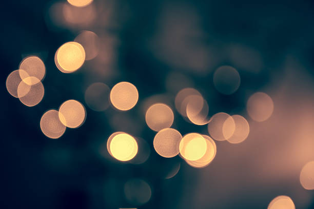 Blue toned blurred chrismas  background  with street lights - foto stock