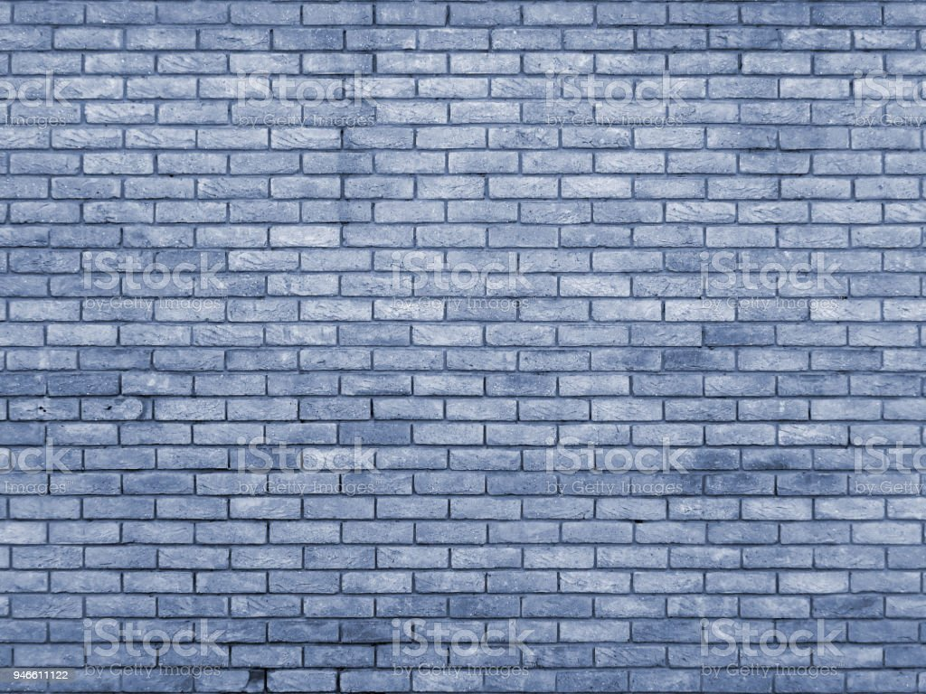 blue toned brick wall  repeating pattern stock photo