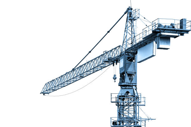 Blue toned construction crane working stock photo