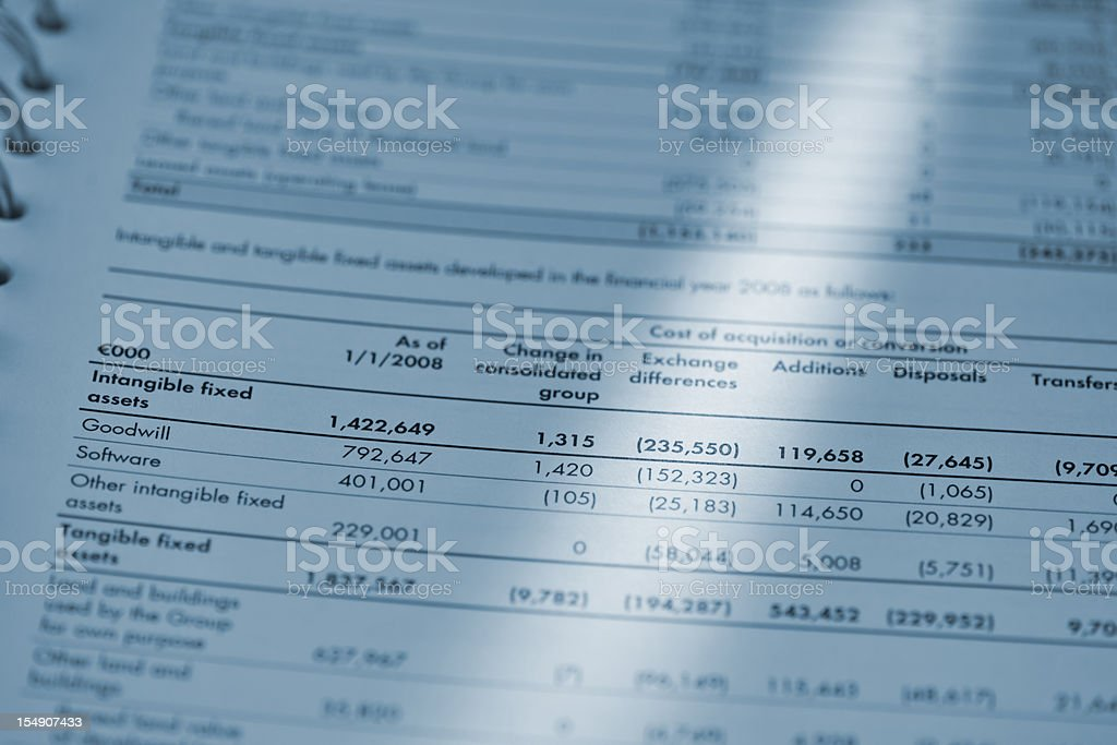 blue toned image of financial report royalty-free stock photo