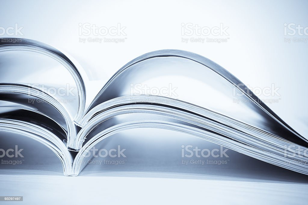 Blue Toned Magazines in Pile royalty-free stock photo