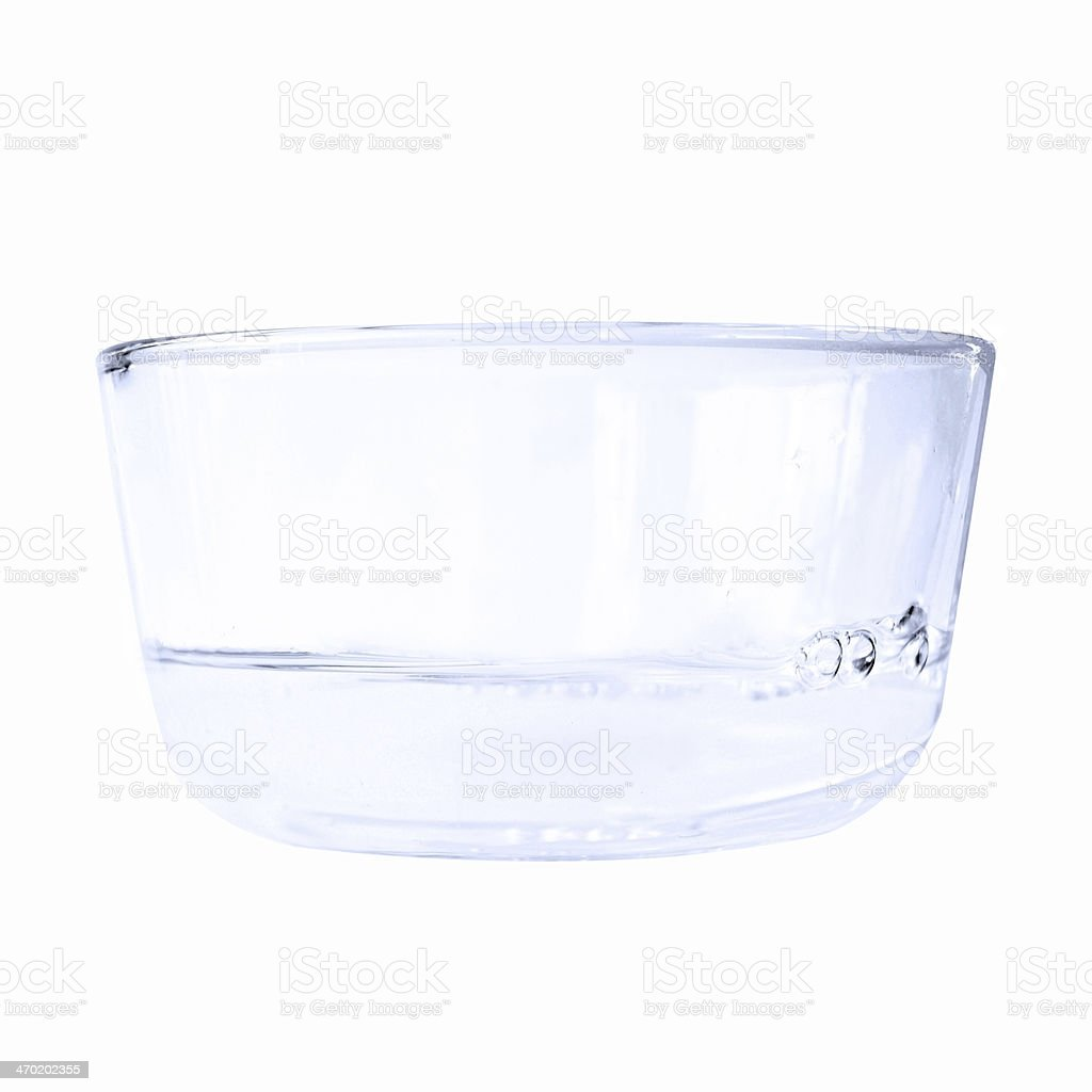 Blue toned water in bowl isolated on white stock photo