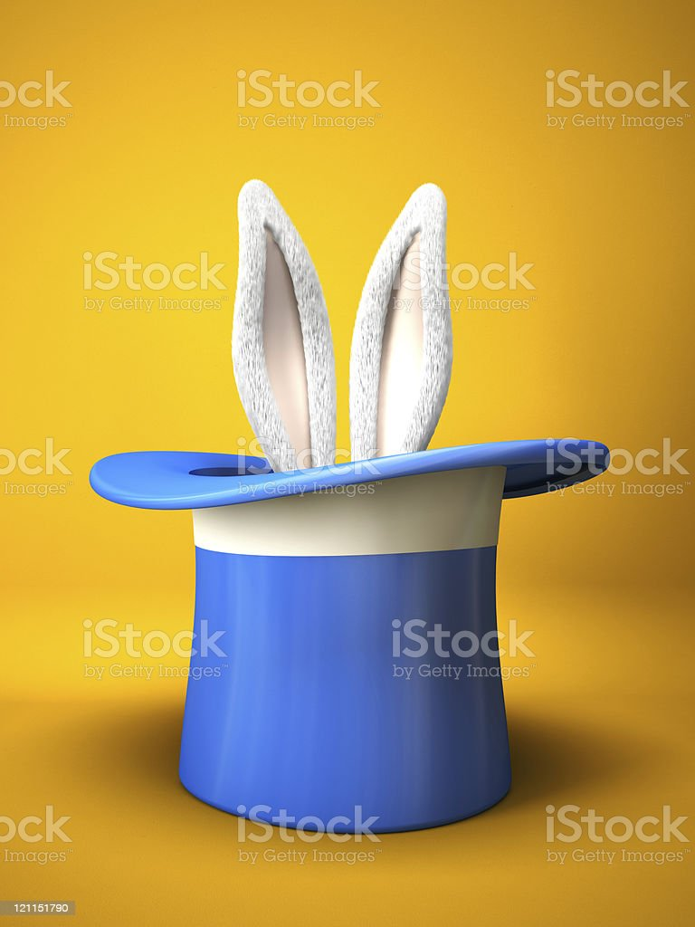 Blue top hat with rabbit ears  isolated on yellow background stock photo