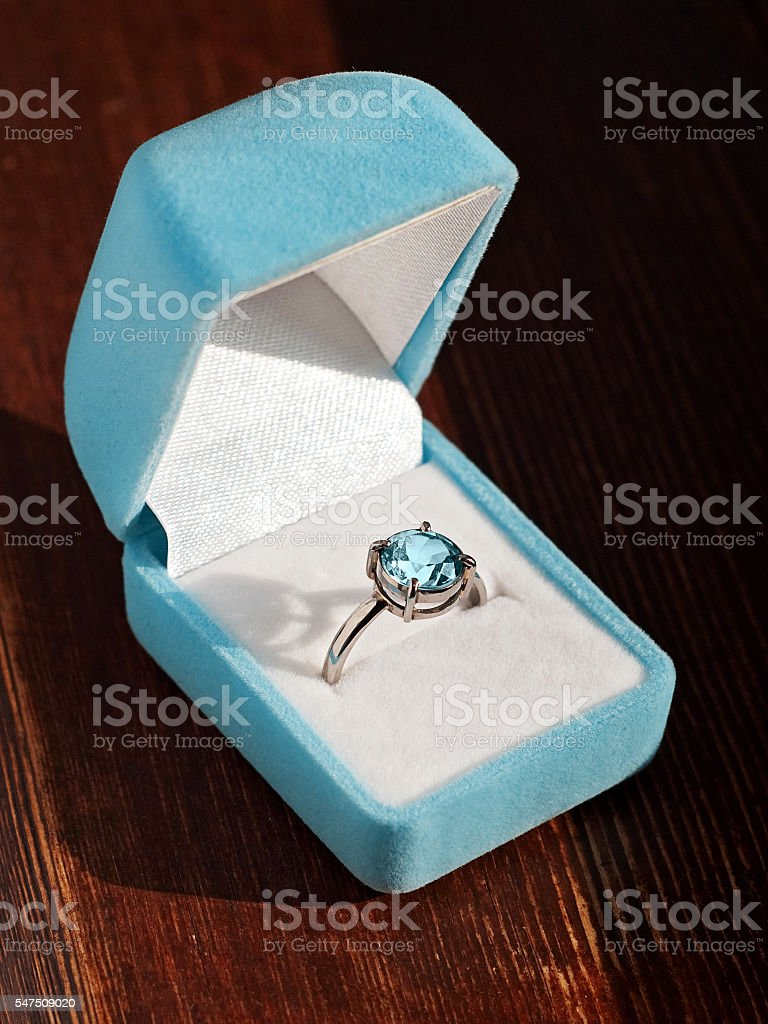 Blue topaz engagement ring stock photo