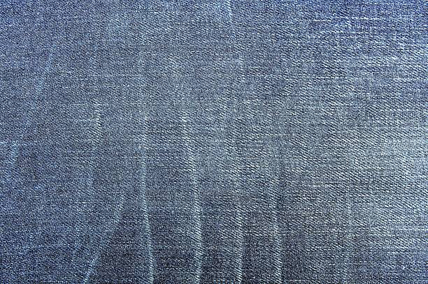 Blue torn denim jeans texture stock photo