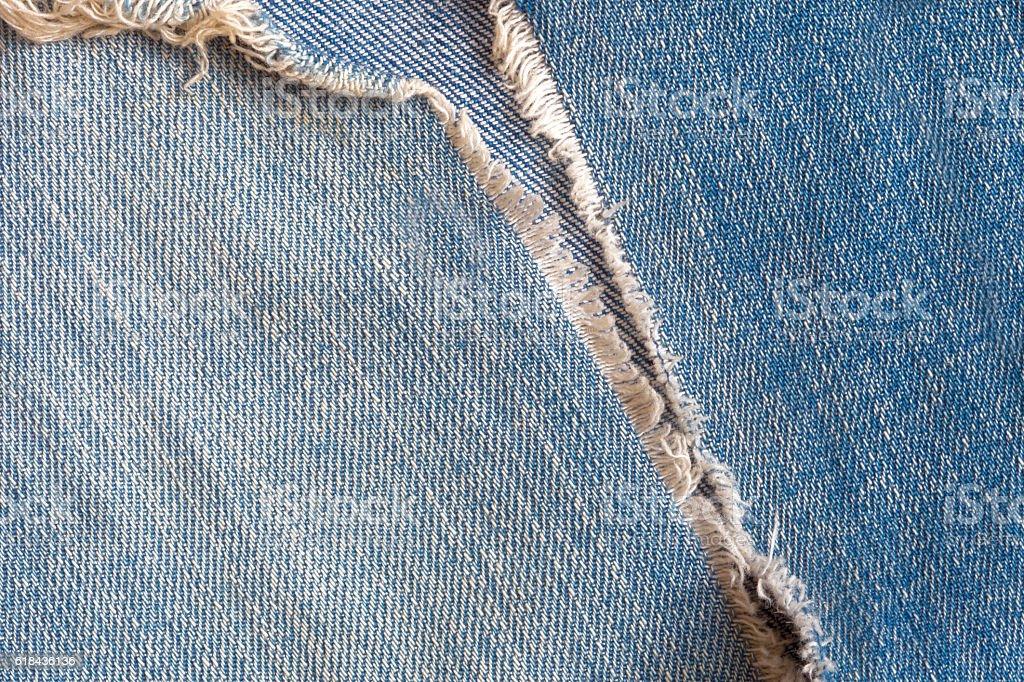 Blue, torn denim jeans texture stock photo