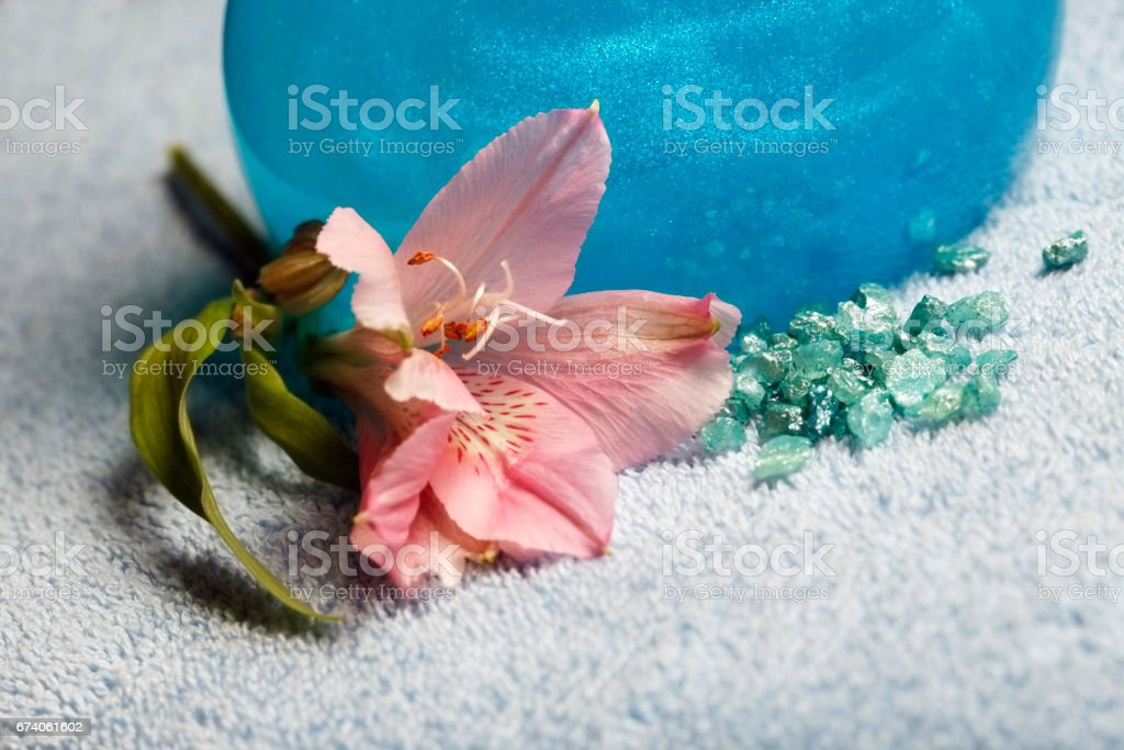 Blue towel and bottle with shampoo royalty-free stock photo