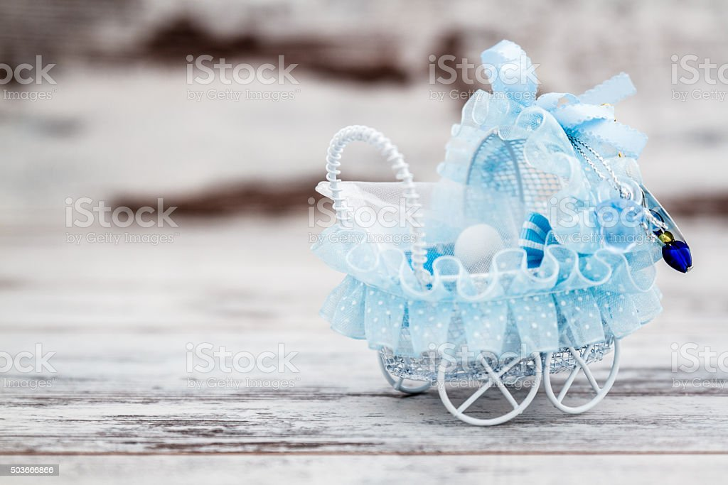 Blue Toy Baby Carriage Prepared for Baby Shower stock photo