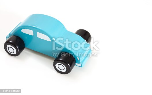 istock A blue toy car, on white background with copy-space. 1129308643
